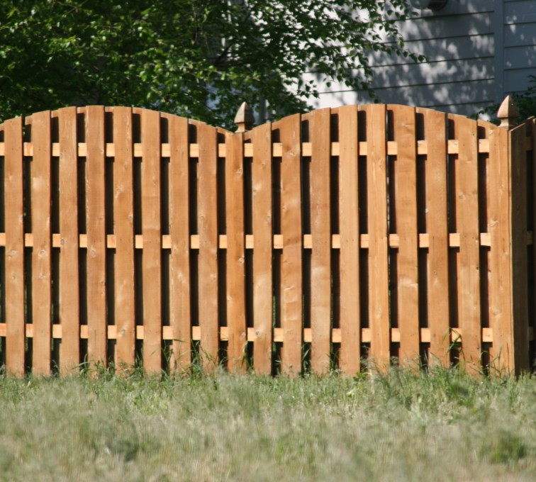 AFC Grand Island - Wood Fencing, 1015 6' overscallop board on board stained