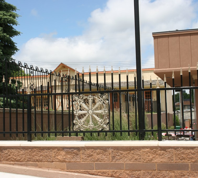AFC Grand Island - Custom Iron Gate Fencing, 1229 Overscallop with quad flare & emblem
