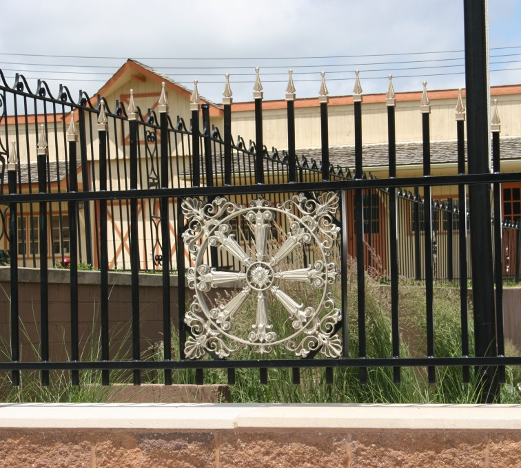 AFC Grand Island - Custom Iron Gate Fencing, 1230 Overscallop with quad flare & emblem