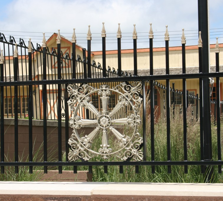 AFC Grand Island - Custom Iron Gate Fencing, 1231 Overscallop with quadflare & emblem