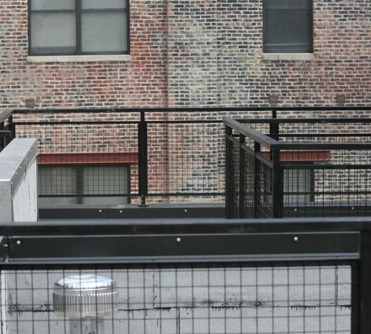 AFC Grand Island - Custom Railing, 2204 Railing with mesh infill