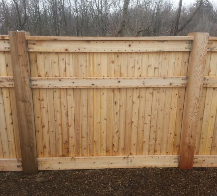 AFC Grand Island - Wood Fencing, 6' Custom Wood With Stone Columns - AFC- IA