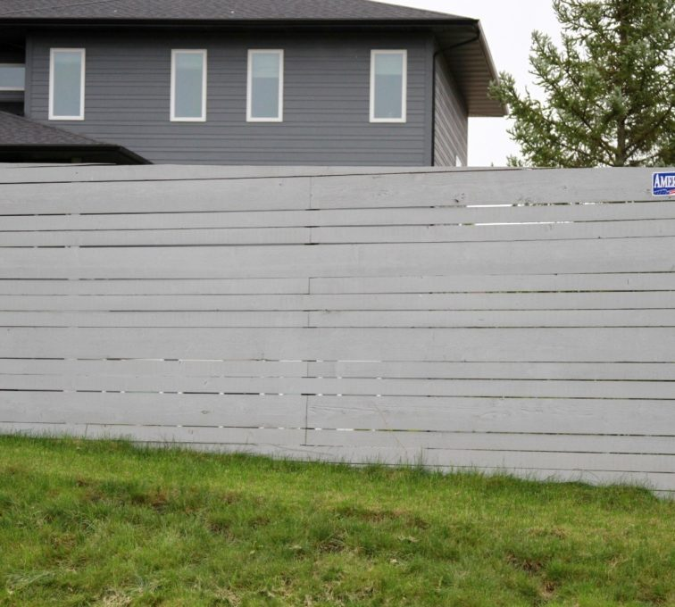 Custom horizontal wood fence on an incline