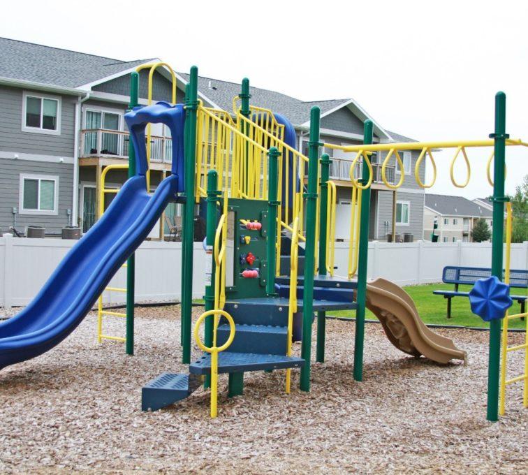 Playground equipment with 2 slides, monkey bars and stairs