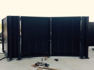 Fire code compliant screen doors installed on a black louver system